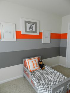 I like the big chunky lines on this feature wall...I'd like one small striped feature wall in their room