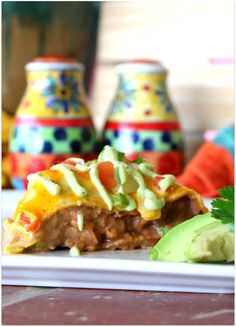 Make any day a 'Taco Tuesday' with this delicious Easy Taco Bake! It takes just a few minutes to put this dinner together, and it may take even fewer for your family to devour it and ask for seconds! It's THAT good! Layers and layers of savory deliciousness piled one on top of the other and then smothered in cheese and an avocado drizzle that is almost too good to be true! Try one tonight!