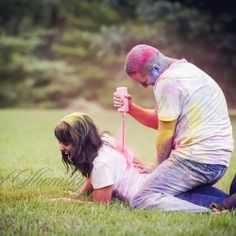 A fun engagement photo session paint war! Photos by: Rachel Shomsky. CUTEST THING EVER!