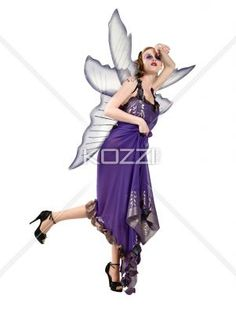 young woman posing in fairy costume. - View of a young woman posing in fairy dress over white background, Model: Anastasia Jung