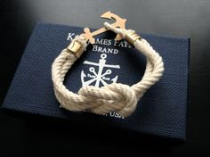 Anchor bracelet. Kiel James Patrick Brand sells them for around US$40. The Etsy shop kikiandcoco sells their own men's anchor bracelets for around 30USD.