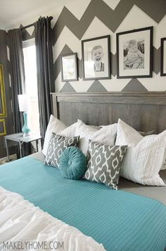 Love the idea of 3 pillows across the king size bed. 2 just doesn't cut it. Love the entire look too!