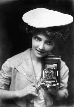 """Kodak Girl"" with Kodak Folding Pocket No. 3, 1909"