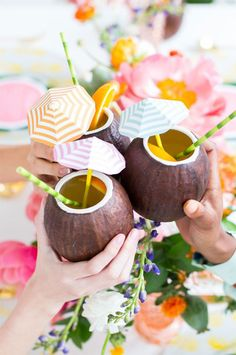 Sip your tropical drinks out of coconut cups with straws + umbrellas at your summer 30th birthday party.