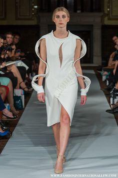 Lenie Boya S/S 2015 London Fashion Week. Futuristic white dress with fabric manipulation details and 3D surrealist bracelet sleeves.