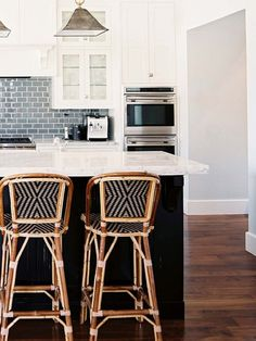 Love the dark island base, and white cabinets,