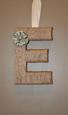 Super cute and easy project. Choose your own font and save money by cutting your letters out of cardboard instead of buying block letters.