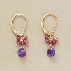 """FASCINATION EARRINGS--Pink rhodalite garnets flitter atop amethyst briolettes in earrings handcrafted exclusively for us. 14kt goldfill with lever back wires 1""""L."""