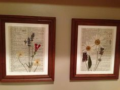 Framed dried flowers on a dictionary page. I'm thinking foreign newspapers for mine