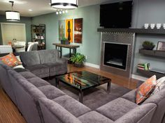 A modern sectional unifies and divides a space with its neutral color and strong sense of form on HGTV's Run My Makeover.
