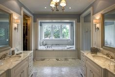 What a grand bathroom!  It's a great setup for his and his space-sharing.
