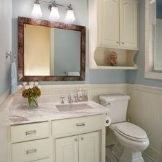 'above toilet storage - Google Search' from the web at 'https://i.pinimg.com/236x/c8/02/22/c80222c974bddda184ba75d57b6d5b4b--over-toilet-storage-bathroom-storage.jpg'
