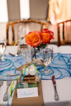 Teal for a beach wedding - make it more modern with pops of coral or orange. Bamboo chairs add an earth element and give the room weight