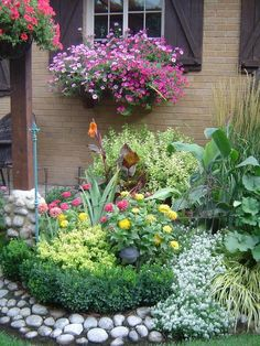 Great use of rock around the flower bed.