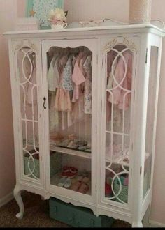 Turn an old china cabinet into a baby armoire.