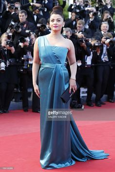 Indian actress Aishwarya Rai poses on May 21, 2013 as she arrives for the screening of the film 'Behind the Candelabra' presented in Competition at the 66th edition of the Cannes Film Festival in Cannes. Cannes, one of the world's top film festivals, opened on May 15 and will climax on May 26 with awards selected by a jury headed this year by Hollywood legend Steven Spielberg.