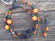 Wear October w/ style with Treats-N-Tricks necklace and earrings. Wood, glass, acrylic, and Hematite!