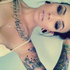 she is just stunning.... this is how I would love to look.  Too bad my husband doesn't like tattoos =(
