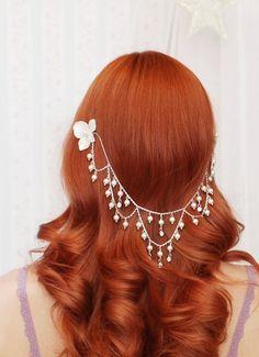 a whimsical pearl headdress.