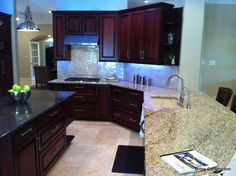 Light floor, dark cabinets  As much as I like pearly finishes this pearlized backsplash does not work with warm granite
