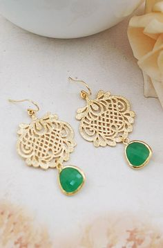 Gold Earrings with Green Accent Stones. Great for year-round use! You'll find them on Etsy.