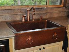 Copper Farm Front Sink with Hand Hammered Copper Rings - Mountain Copper Creations out of Montana.