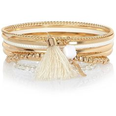 River Island Gold tone bangle bracelets pack ($14) ❤ liked on Polyvore featuring jewelry, bracelets, accessories, hinged bracelet, tassel jewelry, gold tone bangles, river island and bracelets bangle