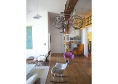 seriously like this bike storage.and indoor swing.just need this house Casa Loft, Loft House, Apartment Therapy, Hanging Bike Rack, Garage Velo, Bike Storage Apartment, Renters Solutions, Bike Storage Solutions, Storage Ideas