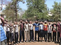 """Tanzanian children try out their eclipse glasses in anticipation of the total eclipse on 2013-11-03. Telescopes to Tanzania is supported by Astronomers without Borders and is an initiative to bring astronomy to those involved in education in Tanzania. (Credit: Chuck Ruehle / Telescopes to Tanzania / Astronomers Without Borders) Mona Evans, """"Solar Eclipses"""" http://www.bellaonline.com/articles/art28395.asp"""