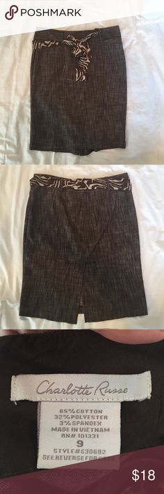 Pencil Skirt Brown pencil skirt with zebra accent belt and two small pockets in the front. Size equivalent to 6 in women's department. Zipper in the back. Fabric belt is removable. Charlotte Russe Skirts Pencil