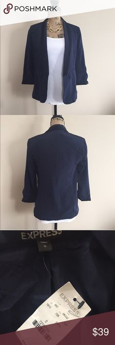 NWT Express navy blazer Pretty navy blue lightweight blazer from Express has contrasting black on lapels and cuffs. Slight padding in shoulders for proper hang and shaping of jacket. Fully lined. Size 0. 100 % polyester. Perfect for season transition with jeans and heels! Express Jackets & Coats Blazers