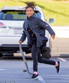Another talent: Jaden Smith, 17, showed off his skateboarding chops in Calabasas, Californ...