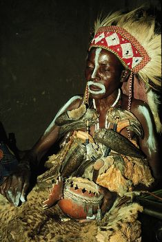 Africa | Luba female diviner reading contents of a gourd, Katanga Province, Democratic Republic of the Congo, 1988. Photo by Mary Nooter Roberts.