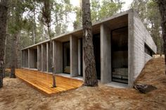 I would love to make this modern concrete design house in the woods my home