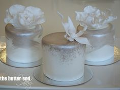 Silver topped mini cakes with exquisite sugar flowers.