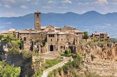 Photo about Italian Hilltown Civita di Bagnoregio. Image of ancient, hill, image - 26413733 Summer Shots, Medieval, Shot Photo, Tuscany, Mexico, Skyline, Exterior, Italy, Stock Photos