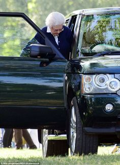 Her Majesty is a keen driver and hopped into the driver's seat...