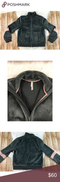 """NWT Free People Movement Fleece Zip Up Jacket NWT Free People Movement Fleece Zip Up Jacket. Tag says green, but color is more gray. Pockets are stitched in the middle, but can be undone for convenience.  comes from a smoke free, pet friendly home. 🚫NO TRADES!  Measurements: -Armpit to Armpit: 20"""" -Shoulder to Shoulder: 14.5"""" -Top To Bottom: 22.5"""" -Armpit To Bottom: 13.5"""" Free People Jackets & Coats"""