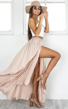 Escape the heat with this gorgeous beige maxi skirt, featuring a high leg split and tassel waist tie. It is the perfect day to twilight look.