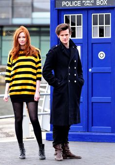 The Doctor, Pond, and the TARDIS. I love Matt's coat and boots. :)