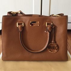 Michael Kors Medium Bedford Leather Satchel Color: Luggage. Gold hardware. 2 zipper compartments and 4 small pockets inside. Bottom is slightly lighter due to storing without dust bag - hardly noticeable. 9H x 12W x 5D Michael Kors Bags Satchels