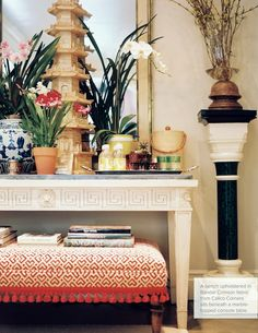 A patterned red ottoman tucked beneath a white marble-topped table Red Ottoman, Ottoman Cover, Chinoiserie Chic, Oui Oui, Do It Yourself Home, Classic House, Timeless Classic, Classic Style, Vignettes
