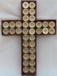 Hey, I found this really awesome Etsy listing at https://www.etsy.com/listing/182071895/gold-shotgun-shell-cross-with-a