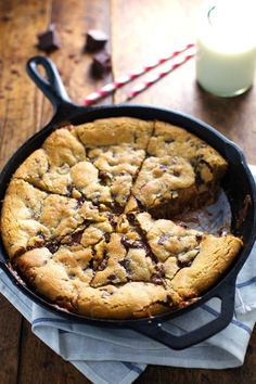 DEEP DISH CHOCOLATE CHIP COOKIE WITH CARAMEL AND SEA SALT baked in a cast iron skillet