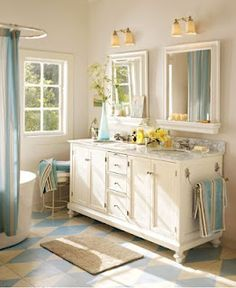 """I love the look of two separate mirrors about a double sink! One of these days I am ripping my """"builder's special"""" mirrors out!"""
