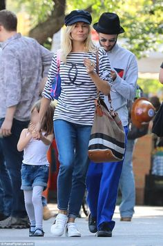 Happy family: In New York Sienna Miller and her ex-fiancé Tom Sturridge looked to on good ...