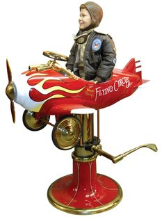 """Child's barber chair, airplane, """"Waldo Pepper's Flying Circus"""", prof restored, Exc cond, 51""""H x 36""""W x 48""""L.  Complete w/child mannequin as shown. http://www.richpennauctions.com/"""