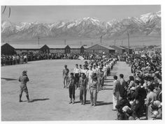 Manzanar, Calif.--Memorial Day services at Manzanar, a War Relocation Authority center where evacuees of Japanese ancestry will spend the duration. American Legion members and Boy Scouts participated in the services. Photographer: Stewart, Francis Manzanar, California. 5/31/42
