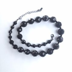 """Black Beveled Beaded Necklace Black Beveled Beaded Necklace // shorter length (16"""") // beveled cuts make it reflect the light and sparkle more // is heavier in weight // good for dressing up a casual outfit or for wearing for a night on the town // non-smoking home ........ 20% off 2+ Bundles // Same Day or Next Day Shipping!!  2.29.11 Jewelry Necklaces"""