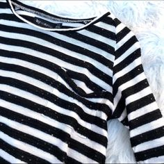 Urban outfitters striped sequin top Super chic striped sequin top with pocket by byCorpus at urban outfitters. Great condtion! 50% rayon 50% polyester Urban Outfitters Tops Tees - Long Sleeve